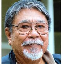 Kenneth T.  Asato