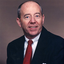 Raymond E.  Plotts