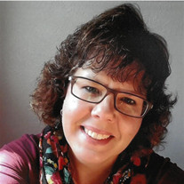 Nicole E. Jenks