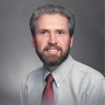 Wayne M Barnes