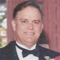 Dr. John  Dennis  Plut