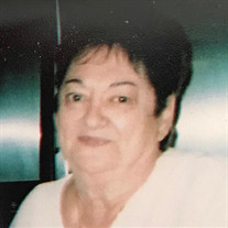 Joan J Valadez