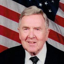 James E. Bredensteiner