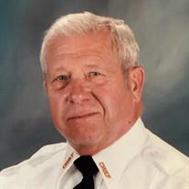 Glenn E.  Houk