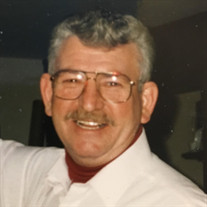James E. Greely