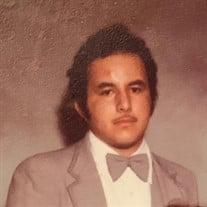 Adolph  M.  Delgado