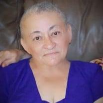 Luz M. Benique
