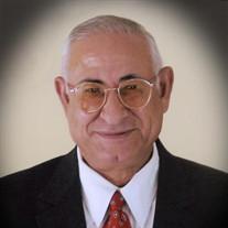 Max L. Riad