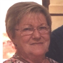 Janet M Clayton