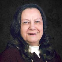 Beverly J Miller
