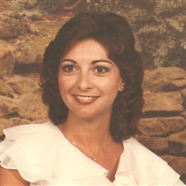 Anita M. Ottem