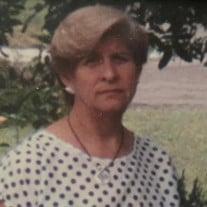 Carmela M. Saldana