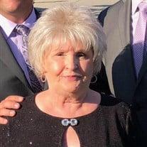 Mrs Jeanne Costa