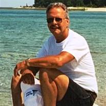 Glen E. Migit