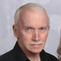 Scott E.  Hughes