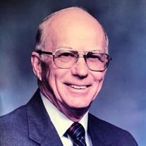 John  E. Asper