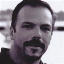 Eric J. Mages