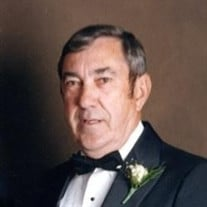 FRANK E. HARRIS