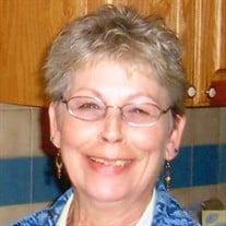 ELAINE M. THAYER