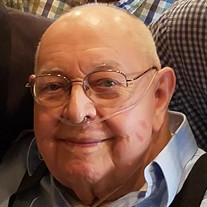 John E. Taube