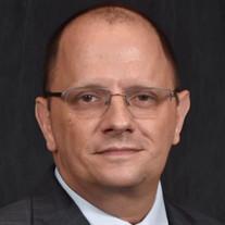John W.  Kozel