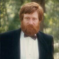 John D.  Quast