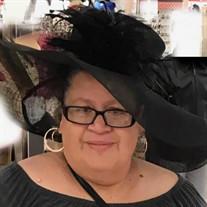 Ms.  Socorro Benitez