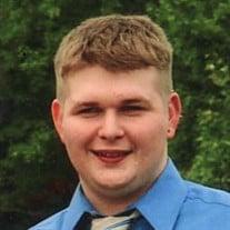 Adam J. Schienda
