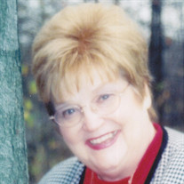 Claudia G Bell