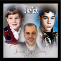 Justin M. Creely