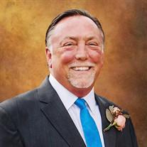 Clay E. Malcom