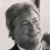 MARK E. DIKOVICS