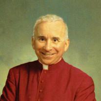Rev. Monsignor John  F. Morales J.C.D.