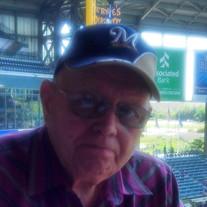Earl M.  Rynders
