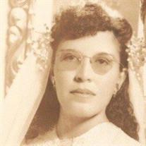 Maria L. Benavides