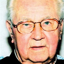 Rev. John W.  Lange, SJ
