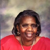 Marcia J Amos