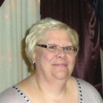 Tina  L.  Schmaltz