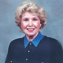 Joan R.  Adams