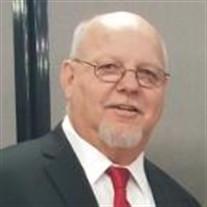 Travis E. Rhea