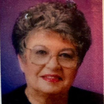 Mrs Marian E Simpson