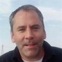 Chad L. Metzger