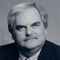 Elmer J.R. Thomas