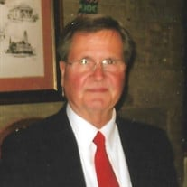 James E. Stricker