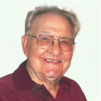 Louis E. Suto