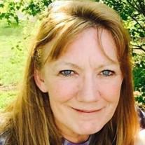 Susan M Busch