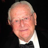 Dr. LOUIS H. BARNETT