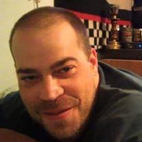 Eric R Kokos