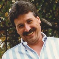 Craig L. Holcomb