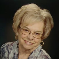 Carol A. Paige